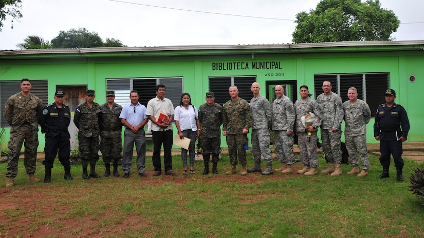 PUERTO LEMPIRA, Honduras – Participants from a bi-lateral discussion pose for a photo June 18, 2015, in Puerto Lempira, Honduras. The participants included leadership from Gracias a Dios Department as well as the Special Purpose Marine Air Ground Task Force-Southern Command and Joint Task Force-Bravo; the meeting provided clarity on the Marines' upcoming construction projects in Gracias a Dios.   (U.S. Air Force Photo by Capt. Christopher Love)