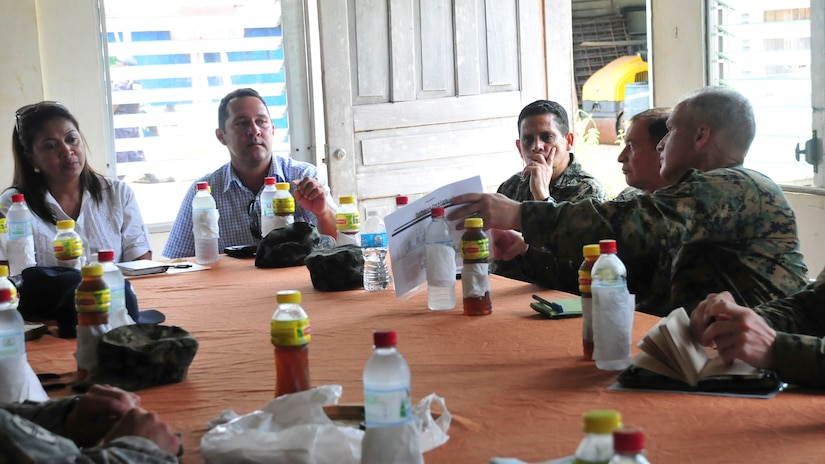 PUERTO LEMPIRA, Honduras – U.S. Marine Corps Lt. Col. David Hudak, Special Purpose Marine Air Ground Task Force-Southern Command commander, shows Gracias a Dios Department leaders the Marines' plans to build a school in Puerto Lempira, Honduras, June 18, 2015. The Honduran delegation included the Ministry of Education representative for Gracias a Dios, Marelin Bendles (left), and the Governor of Gracias a Dios, Alberto Haylock (center left), among others. (U.S. Air Force Photo by Capt. Christopher Love)