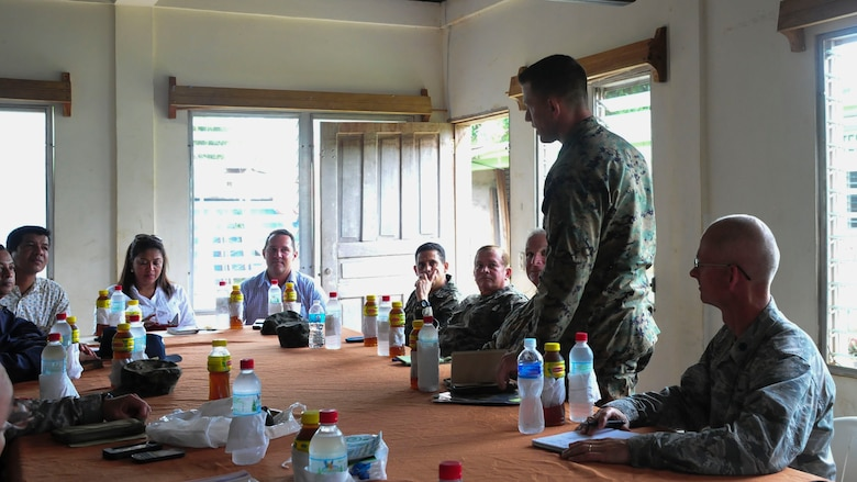 PUERTO LEMPIRA, Honduras – U.S. Marine Corps Maj. Brandon Cooley, Special Purpose Marine Air Ground Task Force-Southern Command operations officer, introduces himself to leadership from the Gracias a Dios Department during a bi-lateral meeting in Puerto Lempira, Honduras, June 18, 2015. The visit enabled Honduran and U.S. members to discuss the Marines' upcoming construction projects, answer questions, determine support requirements and build relationships between partner nations. (U.S. Air Force Photo by Capt. Christopher Love)
