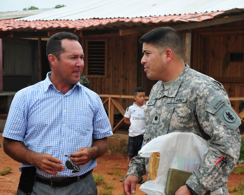 PUERTO LEMPIRA, Honduras – U.S. Army Lt. Col. Carlos Moya, Joint Task Force-Bravo director of civil-military relations, greets Alberto Haylock, Governor of Gracias a Dios Department, after landing at the Puerto Lempira Airport, Honduras, June 18, 2015, for a bi-lateral meeting. Moya, a year-long veteran of JTF-Bravo, came to introduce Haylock and other Gracias a Dios Department leaders to the newly arrived members of the Special Purpose Marine Air Ground Task Force-Southern Command, who will begin construction of a school in Puerto Lempira next week. (U.S. Air Force Photo by Capt. Christopher Love)
