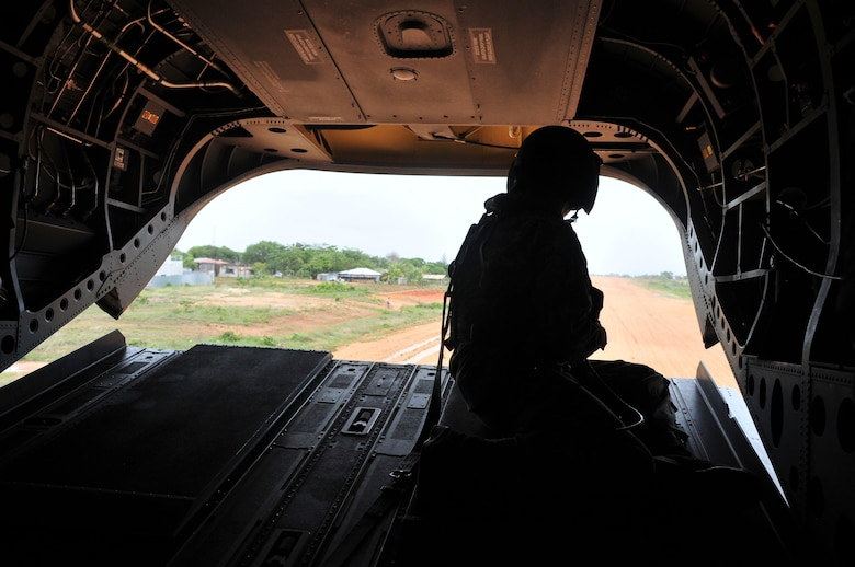 PUERTO LEMPIRA, Honduras – U.S. Army Sgt. Dane Rogge, 1-288th Aviation Regiment crew chief, watches from the back of a Ch-47 Chinook as it lands at the Puerto Lempira Airport, Honduras, June 18, 2015. Dane and the rest of the 1-228 crew enabled a bi-lateral visit between leaders from the Special Purpose Marine Air Ground Task Force-Southern Command and Joint Task Force-Bravo, both stationed at Soto Cano Air Base, Honduras, and leaders from the Gracias a Dios Department. (U.S. Air Force Photo by Capt. Christopher Love)
