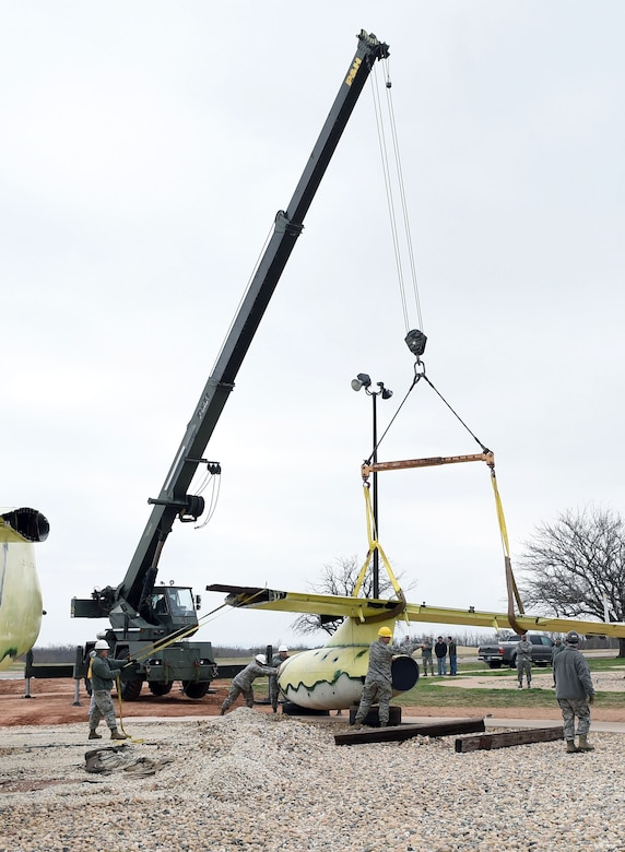 Dyess Airmen assemble an RB-66B Destroyer at the Linear Air Park Feb. 21, 2015, at Dyess Air Force Base, Texas. The RB-66 is one of the newest additions to the two-mile-long outdoor exhibit that showcases the historic success of Air Force and Army Air Corps' use of airpower since the 1940s. (U.S. Air Force photo by Staff Sgt. Joel Mease/Released)