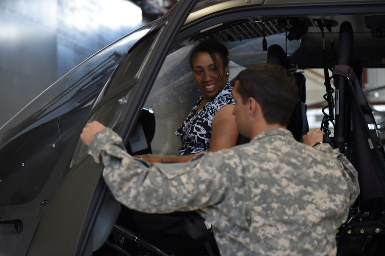 Aiesha Morris tours a Lakota helicopter as part of the first Spouse Appreciation tour July 17, 2015, on Buckley Air Force Base, Colo. The group started their tour at the 460th Space Wing headquarters building and then made their way to the Mission Control Station, radomes and Army Aviation Support Facility. (U.S. Air Force photo by Airman 1st Class Emily E. Amyotte/Release)