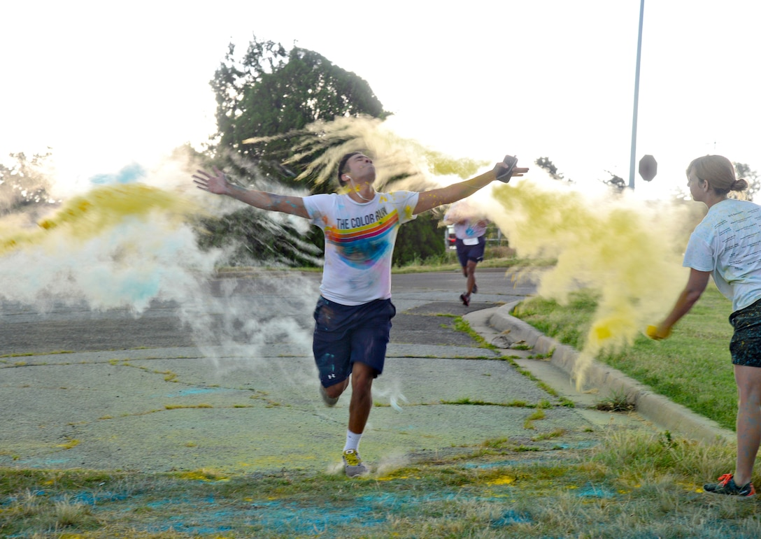 A rainstorm on the horizon didn't stop the 2015 Diversity Day 5K Color Run on June 12. Crossing the finish line in a cloud of color is Senior Airman Briante Brown from the 552nd Air Control Network Squadron. The top three male runners were 2nd Lt. Neal Lucas, 960th Airborne Air Control Squadron; Maj. Jonathan Clough, 963rd Airborne Air Control Squadron; and Cadet Nate Woodford, U.S. Air Force Academy. The top three women were Senior Airman Patricia Hall-Coleman, 552nd Aircraft Maintenance Squadron; Capt. Jeri-Lynn Harper, 965th Airborne Air Control Squadron; and Airman 1st Class Jolanta Gorska, 552nd Maintenance Squadron. (Air Force photo by Kelly White/Released)