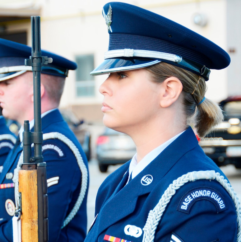 The firing party stands ready to give a 21-gun salute. (U.S. Air Force photo by Ed Aspera)