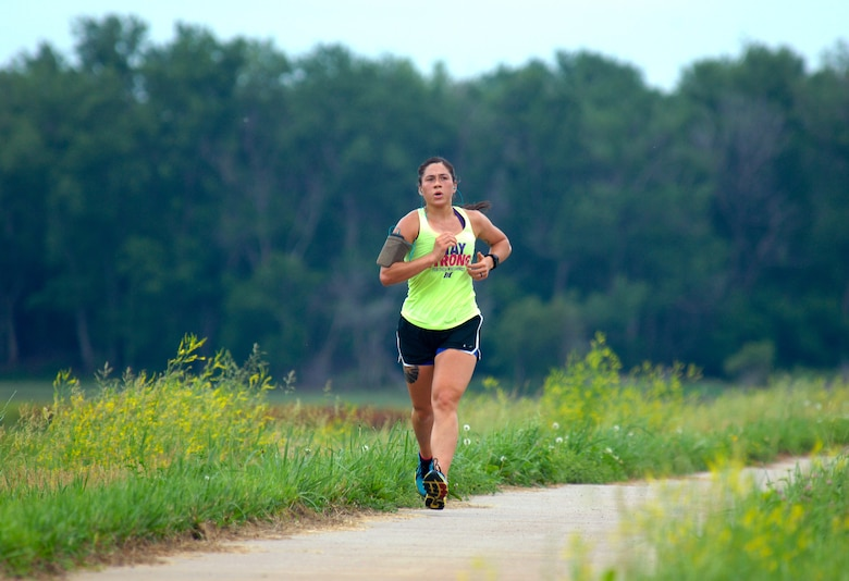 U.S. Air Force Senior Airman Mary Caitlin Dominguez, who is assigned to the 55th Intelligence Support Squadron at Offutt Air Force Base, Neb., participates in a Rainbow Fun Run/Walk on the Keystone Trail in Bellevue, Nebraska June 12 to promote diversity. The event was one of many events planned by the Offutt AFB Diversity Awareness Team during the month of June, which is recognized as the lesbian, gay, bisexual and transgender pride month. Nearly 40 people from Offutt AFB and the surrounding communities participated in the event. (U.S. Air Force photo by Delanie Stafford/Released)