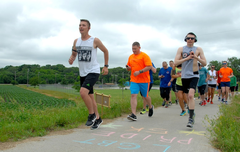 A 5K Rainbow Fun Run/Walk hosted by the Offutt Air Force Base Diversity Awareness Team was held June 12 on the Keystone Trail in Bellevue, Nebraska to promote diversity. The event was one of many events planned during the month of June, which is recognized as the lesbian, gay, bisexual and transgender pride month. Nearly 40 people from Offutt AFB and the surrounding communities participated in the event. (U.S. Air Force photo by Delanie Stafford/Released)