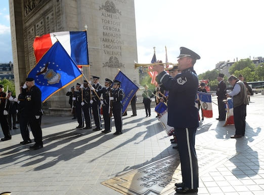 "Master Sgt. Dave Dell, U.S. Air Forces in Europe Band, concludes a Memorial Day ceremony with the playing of ""Taps"" at the Arc de Triomphe, Paris, France, May 24, 2015. Approximately 200 U.S. service members and civilians attended the ceremony to pay tribute to fallen comrades. (U.S. Air Force photo by Maj. Sheryll Klinkel/Released)"
