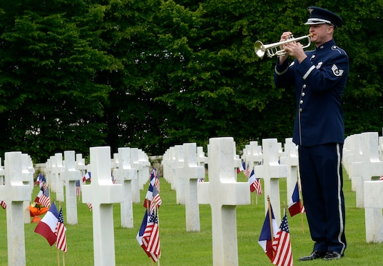 Staff Sergeant Ken Jones from the U.S. Air Forces in Europe Band plays taps during a Memorial Day ceremony at St. Mihiel American Cemetery May 24, 2015, in Thiaucourt, France. More than 4,100 U.S. military members from World War I are buried in the cemetery where local community leaders gathered with U.S. Air Forces in Europe servicemembers to honor the fallen to commemorate Memorial Day. (U.S. Air Force photo/Airman 1st Class Tryphena Mayhugh)