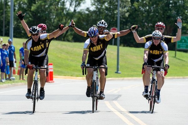 Army visually impaired cycling teams finish together to take gold, silver and bronze during the 2015 Department of Defense Warrior Games on Marine Corps Base Quantico in Virginia, June 21, 2015. DoD photo by EJ Hersom