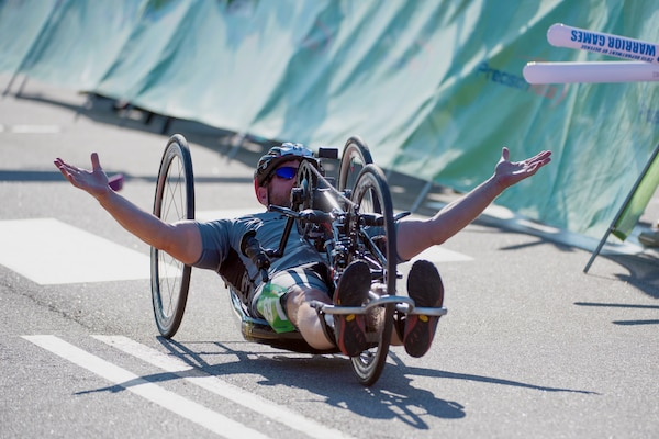 Team Special Operations Command's David Neumer crosses the finish line for gold in men's open hand cycle during the 2015 Department of Defense Warrior Games on Marine Corps Base Quantico, Va., June 21, 2015. Jimenez won gold in the men's H5 hand cycle Division. DoD News photo by EJ Hersom