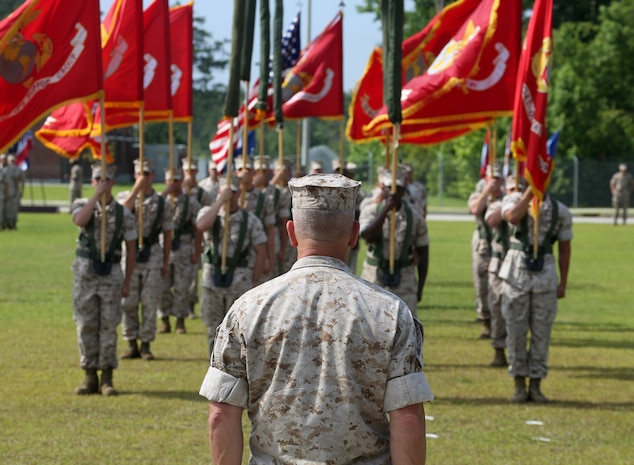 Major Gen. Joseph L. Osterman, commander, U.S. Marine Corps Forces, Special Operations Command, takes his position during the MARSOC re-designation ceremony at Stone Bay, aboard Marine Corps Base Camp Lejeune, N.C., June 19, 2015. The ceremony was held to officially adopt the name Marine Raider, carrying on the heritage and legacy passed along by the Raiders of World War II. During the ceremony, the units' colors were cased and their new colors were unveiled.