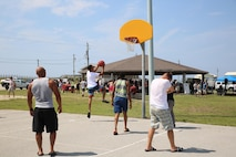 Marines with the Ground Combat Element Integrated Task Force play a game of basketball during a beach bash at Onslow Beach aboard Marine Corps Base Camp Lejeune, North Carolina, June 19, 2015. From October 2014 to July 2015, the GCEITF conducted individual and collective level skills training in designated ground combat arms occupational specialties in order to facilitate the standards-based assessment of the physical performance of Marines in a simulated operating environment performing specific ground combat arms tasks. (U.S. Marine Corps photo by Cpl. Paul S. Martinez/Released)