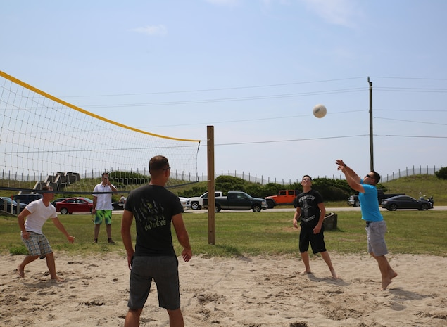 Marines with the Ground Combat Element Integrated Task Force play a game of volleyball during a beach bash at Onslow Beach aboard Marine Corps Base Camp Lejeune, North Carolina, June 19, 2015. From October 2014 to July 2015, the GCEITF conducted individual and collective level skills training in designated ground combat arms occupational specialties in order to facilitate the standards-based assessment of the physical performance of Marines in a simulated operating environment performing specific ground combat arms tasks. (U.S. Marine Corps photo by Cpl. Paul S. Martinez/Released)