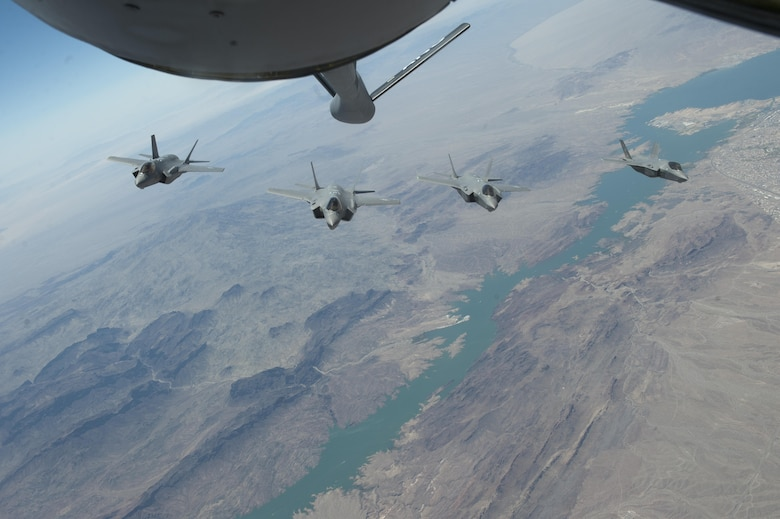 F-35 Lightning IIs from the 61st Fighter Squadron, Luke Air Force Base, Arizona train for air-to-air refueling operations with the 161st Air Refueling Wing, Arizona Air National Guard, June 5, 2015. (U.S. Air Force photo by Staff Sgt. Staci Miller)