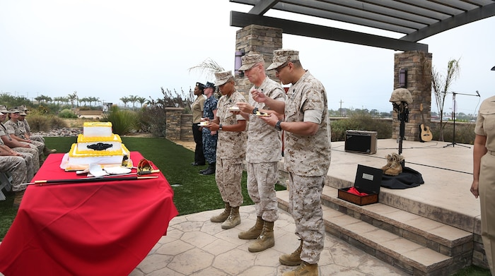 Chief Hospital Corpsman James Boening, center, the oldest corpsman present, Hospital Corpsman Justin Sontoyo, left, the youngest corpsman present, and 1st Medical Battalion's Command Master Chief Edgar M. Santiago, right, eat a piece of cake during the 117th Hospital Corps Birthday ceremony aboard Camp Pendleton, Calif., June 17, 2015. It is naval tradition for the third piece of cake to be passed from the oldest corpsman present to the youngest and for the first piece of cake to be presented to the guest of honor. The Hospital Corps came into existence as an organized unit of the medical department under the provision of an act of congress approved June 17, 1898. The hospital corpsmen work in a wide variety of capacities and locations, including shore establishments such as naval hospitals and clinics, aboard ships, and as the primary medical caregivers for Sailors and Marines while underway and forward deployed. (U.S. Marine Corps photo by Sgt. Laura Gauna/ Released)
