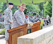 Lt. Col. David DeFelice Jr., commander of the newly reactivated 1st Sqdn., 4th Cav. Regt., 1st ABCT, 1st Inf. Div., provides remarks during the squadron's redesignation ceremony June 5 on the Cavalry Parade Field at Fort Riley. DeFelice discussed the proud history and traditions of both the 1st and 4th squadrons of the 4th Cavalry Regiment and thanked all the current and former soldiers of both organizations that were in attendance for their support.