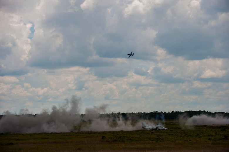 An A-10C Thunderbolt II performs a strafe run after target confirmation from joint terminal attack controllers (JTACs) during Exercise DRAGON STRIKE June 9, 2015, at Avon Park Air Force Range, Fla. The 93d Air Ground Operations Wing JTACs performed close air support coordination during the eight-day exercise. (U.S. Air Force photo by Airman 1st Class Dillian Bamman/Released)