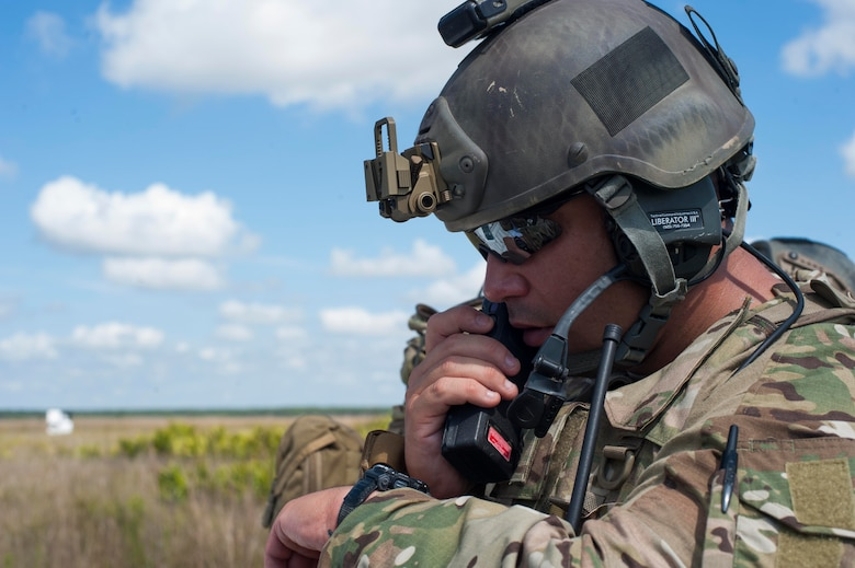 U.S. Army Sgt. 1st Class Joel Sobrado, 3d Infantry Division fire support NCO, calls out GPS coordinates to 3-27th Field Artillery Regiment soldiers during Exercise DRAGON STRIKE June 9, 2015, at Avon Park Air Force Range, Fla. Sobrado and 18th Air Support Operations Group joint terminal attack controllers coordinated with the soldiers on launch locations for M142 High Mobility Artillery Rocket System rockets. (U.S. Air Force photo by Airman 1st Class Dillian Bamman/Released)