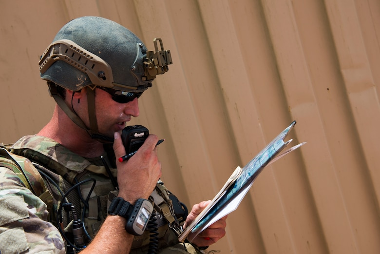 U.S. Air Force Staff Sgt. Robert Cooch, 18th Air Support Operations Group joint terminal attack controller (JTAC), delivers attack coordinates to B-52 Bomber pilots during Exercise DRAGON STRIKE June 9, 2015, at Avon Park Air Force Range, Fla. The B-52 and 75th Fighter Squadron's A-10C Thunderbolt IIs coordinated with the JTACs to deliver close air support for the JTACs. (U.S. Air Force photo by Airman 1st Class Dillian Bamman/Released)