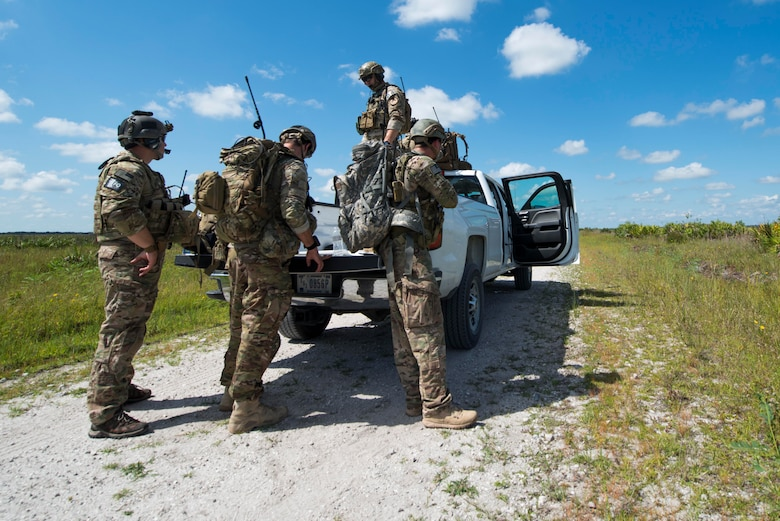 Joint terminal attack controllers (JTACs) from the 18th Air Support Operations Group prepare equipment before a M142 High Mobility Artillery Rocket System (HIMARS) launch during Exercise DRAGON STRIKE June 9, 2015, at Avon Park Air Force Range, Fla. JTACs aided in A-10 strafe runs and personnel recovery missions in addition to the HIMARS launches for DRAGON STRIKE. (U.S. Air Force photo by Airman 1st Class Dillian Bamman/Released)