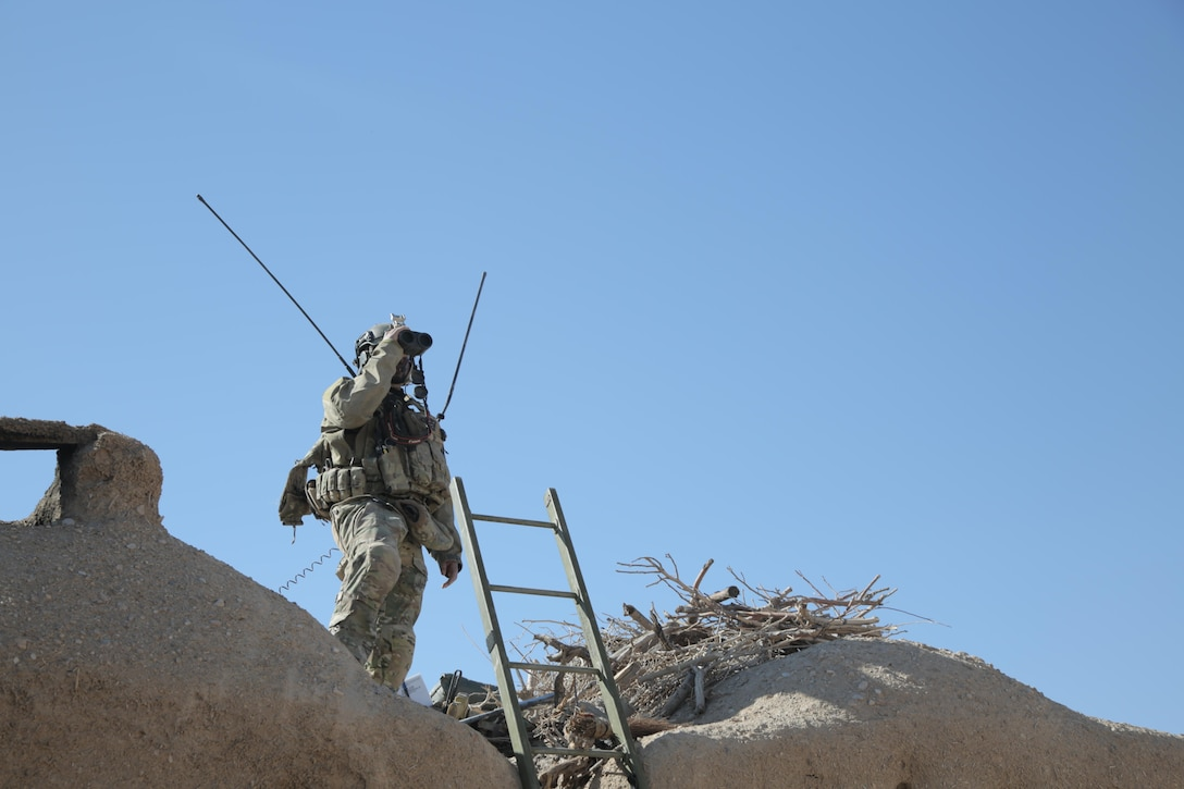 A combat controller, deployed with a U.S. Army Special Forces team in Afghanistan, searches for targets to provide close air support during an engagement with insurgents. A Special Tactics combat controller integrates air power into ground special operations for mission success, deploying into forward hostile areas to control offensive airstrike operations (also known as Joint Terminal Attack Control), as well as establish assault zones and provide air traffic control capability. (U.S. Air Force photo/Released)