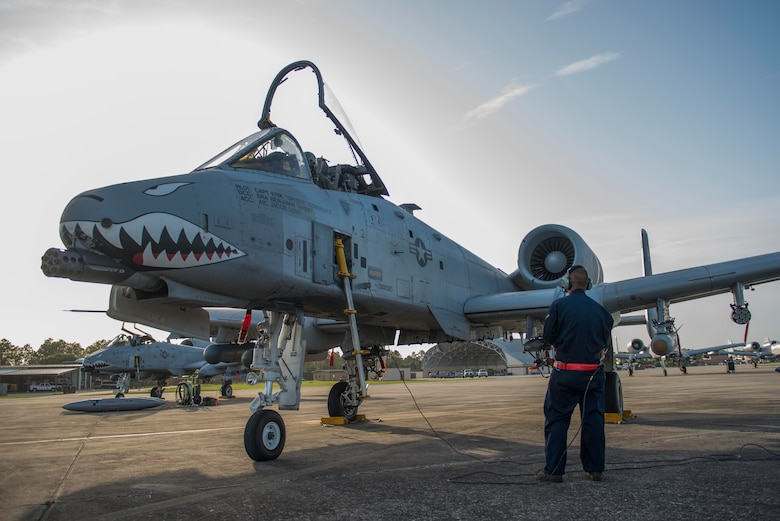 U.S. Air Force Airman 1st Class Jacob Dovel, 23d Aircraft Maintenance Squadron crew chief, coordinates with Capt. Bass Farmer, 75th Fighter Squadron A-10C Thunderbolt II pilot, on pre-flight checks before takeoff during Exercise DRAGON STRIKE June 11, 2015, at Avon Park Air Force Range, Fla. The 23d AMXS provided maintenance for all ten of Moody Air Force Base's A-10s participating in joint terminal attack controller exercises. (U.S. Air Force photo by Airman 1st Class Dillian Bamman/Released)