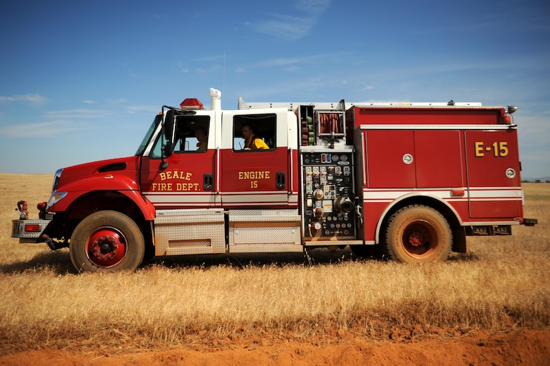 A Beale fire truck is positioned before a controlled burn is ignited June 17, 2015 at Beale Air Force Base, California. The burn consumed approximately 800 acres in an effort to renew cattle grazing land and control vegetation growth. (U.S. Air Force photo by Preston L. Cherry)