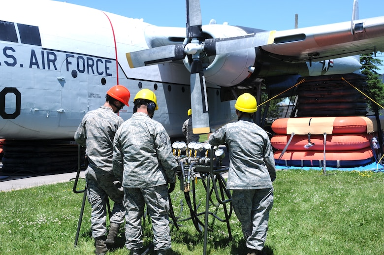 Personnel from the 914th Maintenance Squadron, Crash Damaged and Disabled Aircraft Recover Team monitor air pressure for pneumatic airbags, during an exercise, at the Niagara Falls Air Reserve Station on June 6, 2015. Green led a team of more than 20 personnel through a simulated crash and recovery exercise. (U.S. Air Force photo by Staff Sgt. Matthew Burke)