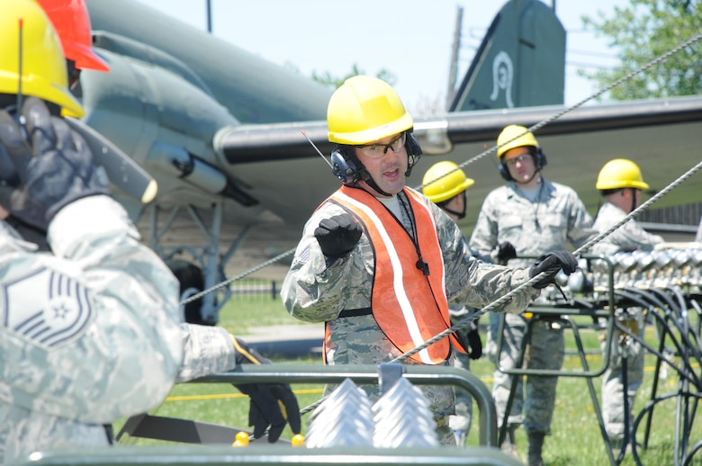 Tech. Sgt. Norman Green, 914th Maintenance Squadron, Crash Damaged and Disabled Aircraft Recover Team Chief, verifies air pressure with members of the CDDAR team at Niagara Falls Air Reserve Station on June 6, 2015. Green led a team of more than 20 personnel through a simulated crash and recovery exercise. (U.S. Air Force photo by Staff Sgt. Matthew Burke)