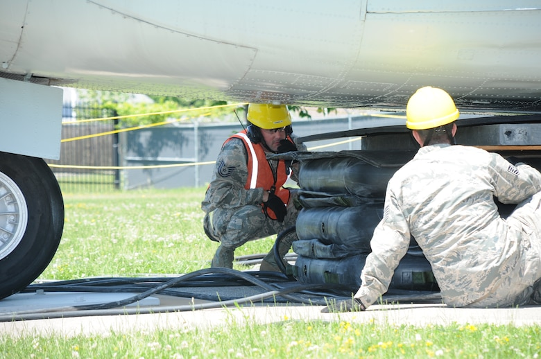 Tech. Sgt. Norman Green, 914th Maintenance Squadron, Crash Damaged and Disabled Aircraft Recover Team Chief, inspects pneumatic airbags with a member of the CDDAR team at Niagara Falls Air Reserve Station on June 6, 2015. Green led a team of more than 20 personnel through a simulated crash and recovery exercise. (U.S. Air Force photo by Staff Sgt. Matthew Burke)
