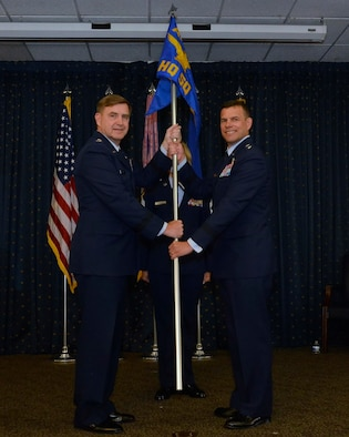 Air Force Assistant Vice Chief of Staff Lt. Gen. Stephen L. Hoog officiates the assumption of command of Air Force Operational Test and Evaluation Commander Maj. Gen. Matthew H. Molloy at Kirtland Air Force Base, N.M., on June 18, 2015. (U.S. Air Force photo/Jamie M. Burnett)