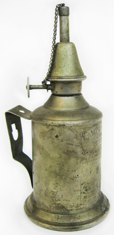 This kerosene lamp was used during World War I by Sgt. 1st Class A.B. Curran of the 103rd Aero Squadron, American Expeditionary Force, Air Service. This lamp was manufactured to burn mineral spirits but could also burn kerosene. Curran used kerosene to fuel this lamp as the supply of mineral spirits was limited during the war. (U.S. Air Force photo)
