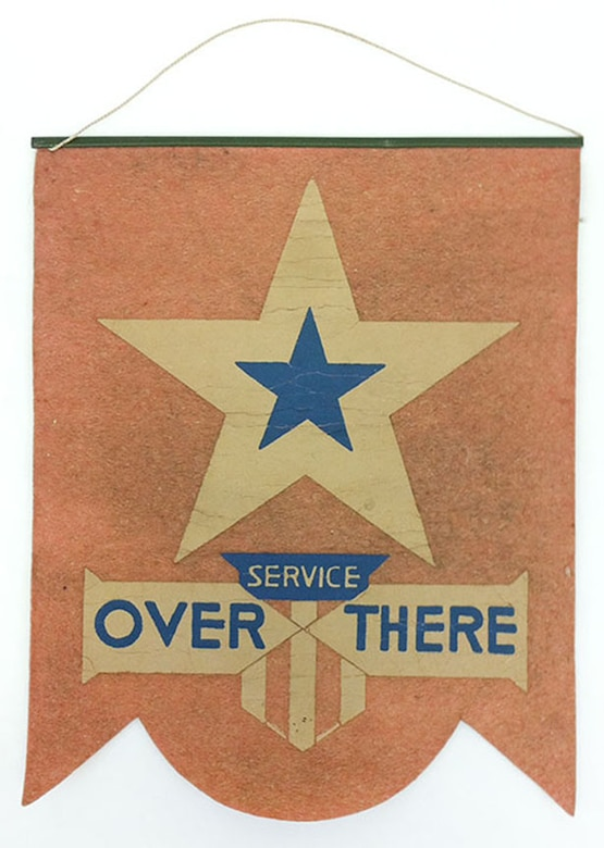 """The title to the popular song """"Over There,"""" written by George M. Cohan in April 1917, was incorporated in the designs of some window star flags.This particular 1-star window flag, which reads """"Service Over There,"""" was displayed in the front window of the donor's grandmother's home to represent the donor's father who was serving in Europe during World War I. (U.S. Air Force photo)"""
