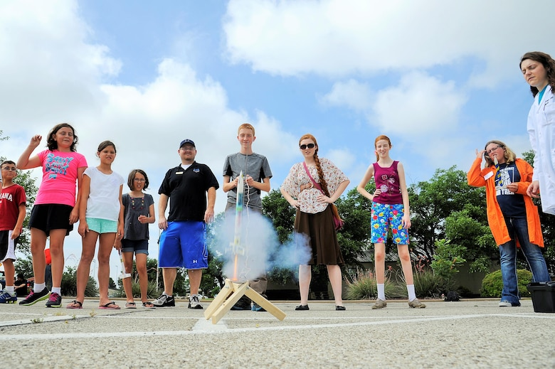 Participants of the 17th Force Support Squadron Youth Programs Science Camp launch a rocket on Goodfellow Air Force Base, Texas, June 19, 2015. Science camp expands and assists U.S. Air Force youths' understanding of a variety of scientific experiments, discoveries and technologies as lifelong skills and potential career choices. (U.S. Air Force photo by Tech. Sgt. Austin Knox/Released)