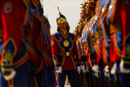 A Mongolian soldier with the Mongolian Armed Forces takes charge of a formation during the opening ceremonies of Exercise Khaan Quest 2015 at Five Hills Training Area in Tavantolgoi, Mongolia, June 15, 2015. Khaan Quest is a regularly scheduled, multinational exercise hosted annually by Mongolian Armed Forces and co-sponsored by U.S. Army, Pacific, and U.S. Marine Corps Forces, Pacific. KQ15 is the latest in a continuing series of exercises designed to promote regional peace and security. This year marks the 13th iteration of this training event. (U.S. Marine Corps photo by SSgt Christopher Giannetti/released)