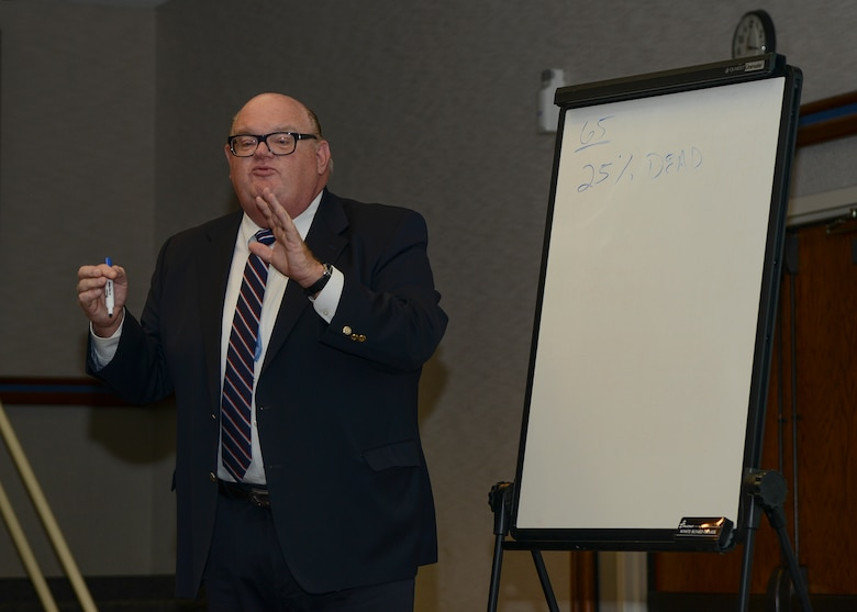 Financial Advisor Scott Alexander taught home buyer's seminar attendees how to financially prepare for home ownership, outlining the various types of loans available to buyers. (U.S. Air Force photo by Rebecca Amber)