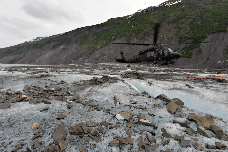 An Alaska National Guard UH-60 Black Hawk helicopter lands on Colony Glacier June 10 in order to transport servicemembers back to Joint Base Elmendorf-Richardson, Alaska. Each summer since 2012 Alaskan Command has supported Operation Colony Glacier by removing aircraft debris and assisting in the recovery of human remains to ensure closure for families who have lost loved ones. (U.S. Air Force photo/Tech. Sgt. John Gordinier)