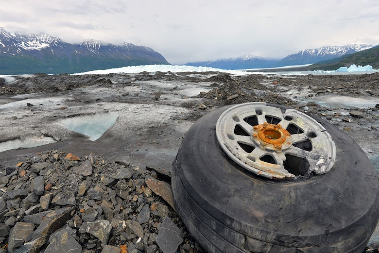 Landing gear from a 1952 C-124 Globemaster II aircraft accident rests on top of Colony Glacier June 10, 2015. Each summer since 2012 Alaskan Command has supported Operation Colony Glacier by removing aircraft debris and assisting in the recovery of human remains to ensure closure for families who have lost loved ones. (U.S. Air Force photo/Tech. Sgt. John Gordinier)