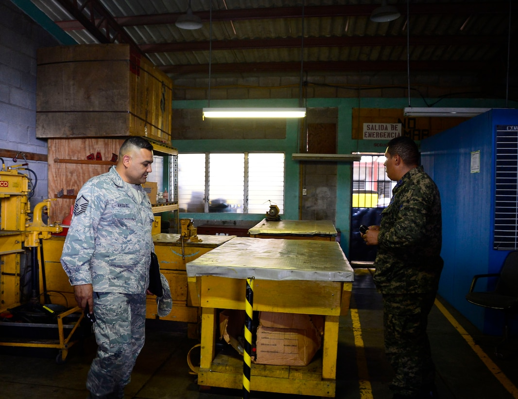 U.S. Air Force Master Sgt. Roberto Vasquez, superintendent of 12th Air Force (Air Forces Southern) Plans, Requirements, and Programs section, discusses the maintenance needs of the Honduran Air Force with Honduran Air Force Sgt. Marcotulio Avila, maintenance chief, stationed at Soto Cano Air Base in Comayagua, Honduras, June 17, 2015. A five-member assessment team from 12th AF (AFSOUTH), Davis-Monthan Air Force Base, Ariz., and the 571st Mobility Support Advisory Squadron from Travis Air Force Base, Cali., focused on the communication, intelligence collection and analysis, and  maintenance capabilities at Hernan Acosta Mejia Air Base, Soto Cano Air Base, Armand Escalon Espinal Air Base and Hector Caraccioli Moncada Air Base. (U.S. Air Force photo by Tech. Sgt. Heather R. Redman/Released)
