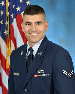 Airman 1st Class Vito Amalfitano, storage management technician for the Joint Personal Property Shipping Office-Northeast at Hanscom Air Force Base, Mass., overcame significant challenges in his background to enter the Air Force. (U.S. Air Force photo by Linda LaBonte Britt)