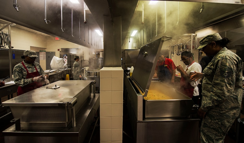 Airmen from the 628th Force Support Squadron Gaylor Dining Facility work to prepare lunch at Joint Base Charleston, S.C. April 08, 2015. 628th FSS Airmen are tasked with providing meals to thousands of fellow Airmen daily. (U.S. Air Force photo by Staff Sgt. Kenneth W. Norman)