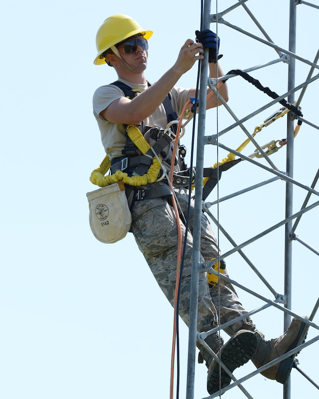 Airman 1st Class Mark Dunton works on upgrading lightning protection and grounding on a communications tower at Pease Air National Guard Base, N.H., on June 22, 2015.The installation of the lightning protection gear helps protect resources such as radios that 157th Air Refueling Wing Airmen use to support the mission.  Dunton is assigned to the 243rd Engineering Installation Squadron, Maine Air National Guard in South Portland, Maine.  (U.S. Air National Guard photo by Staff Sgt. Curtis J. Lenz)