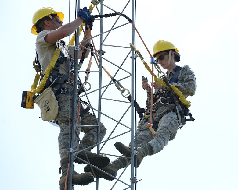 Airman 1st Class Mark Dunton (left) and Senior Airman Samantha Maquillan work on upgrading lightning protection and grounding on a communications tower at Pease Air National Guard Base, N.H., on June 22, 2015. The installation of the lightning protection gear helps protect resources such as radios that 157th Air Refueling Wing Airmen use to support the mission. The Airmen are assigned to the 243rd Engineering Installation Squadron, Maine Air National Guard in South Portland, Maine.  (U.S. Air National Guard photo by Staff Sgt. Curtis J. Lenz)