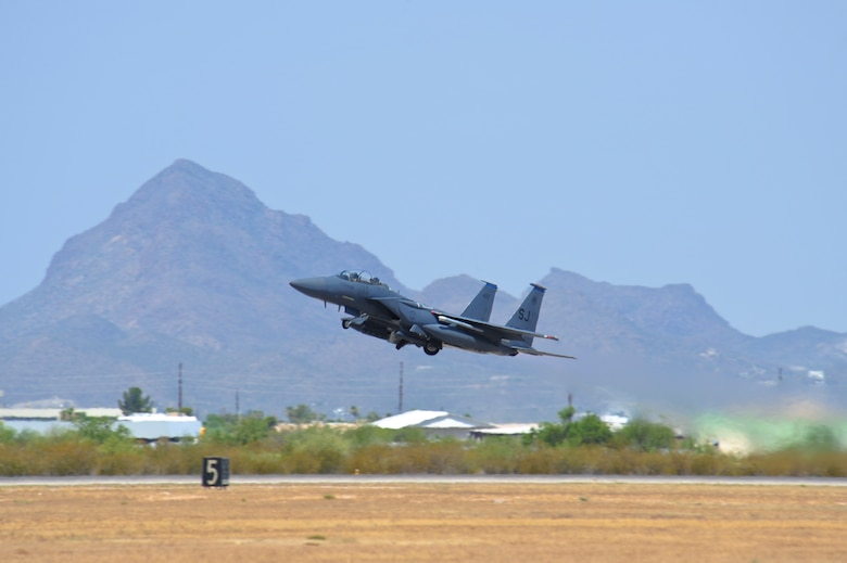 An F-15E Strike Eagle from the 334th Fighter Squadron, Seymour Johnson AFB, N.C., takes off at Davis-Monthan Air Force Base, Ariz., June 22, 2015.  Southern Arizona's military operating area allowed Strike Eagle pilots to train in unfamiliar terrain with F-35 Lightning IIs, F-16 Fighting Falcons and A-10 Thunderbolt IIs.  (U.S. Air Force photo by Airman 1st Class Chris Massey/Released)