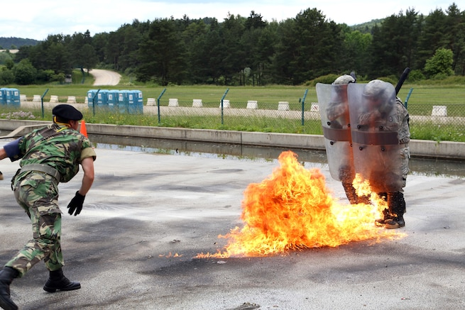 u s department of > photos > photo essays > essay view  n iers move through fire while conducting fire phobia training at the joint multinational readiness center