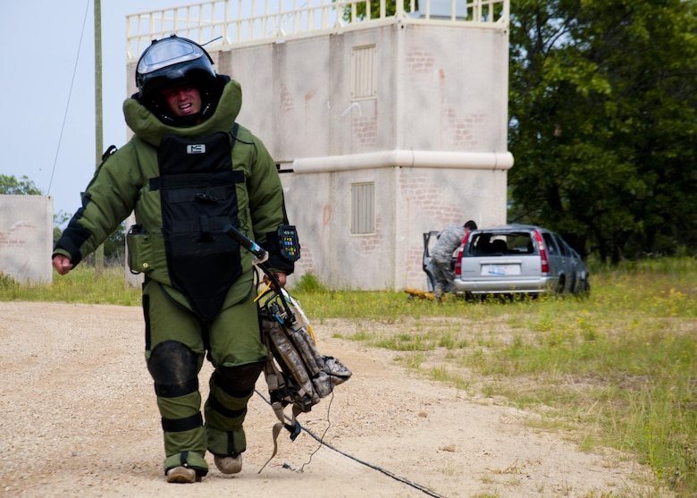 Master Sgt. Shawn Lundgren, 446th Civil Engineer Squadron explosive ordnance disposal technician from Joint Base Lewis-McChord, Washington, walks back to safety after dismantling a simulated improvised explosive device during the Patriot Warrior exercise at Fort McCoy, Wis., June 21, 2015. Patriot Warrior is a joint exercise designed to demonstrate contingency deployment training ranging from bare base buildup to full operational capabilities. More than 6,000 members from the U.S. service branches and their Reserve components, including Air Force, Army, and Navy participated alongside British and Canadian forces. (U.S. Air Force Reserve photo by Senior Airman Daniel Liddicoet)