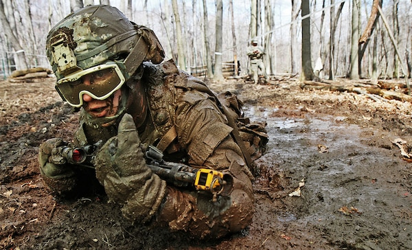 Crawling through mud, Army Pvt. Charles Shidler, Alpha Company, Special Troops  Battalion, 37th Infantry Brigade Combat Team, Ohio National Guard, searches  for the next covered fighting position during individual movement techniques  training at the Camp Ravenna Joint Maneuver Training Center, Ravenna, Ohio,  April 17, 2010. The IMT is just one of more than 200 common training tasks  that Shidler, as well as about 3,600 other Soldiers of the 37th brigade, must  complete before they are scheduled to deploy to Afghanistan in fall 2011 in  support of Operation Enduring Freedom.