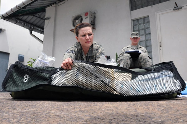 Air Force Staff Sgt. Amber Weaver, an aeromedical evacuation technician with the Wyoming Air National Guard's 187th Aeromedical Evacuation Squadron (foreground) conducts an inventory on inflight medical kits while Air Force Tech. Sgt. Matt Larson, a medical material craftsman with the Minnesota ANG's 109th AES reads off the inventory checklist as part of MEDLITE 11 preparation, April 26, 2011, at the U.S. Embassy in Kinshasa, Democratic Republic of the Congo. MEDLITE 11 is a joint medical exercise focused on aeromedical evacuation, to improve the readiness of U.S. Air Force and DRC personnel