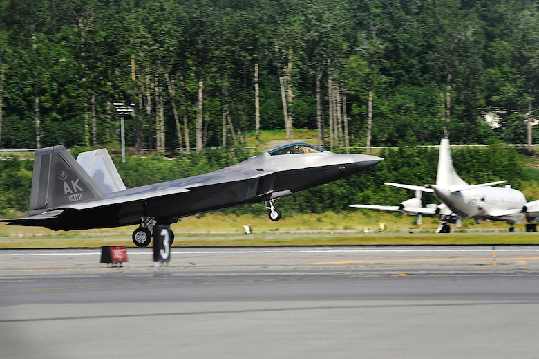An F-22 Raptor from the 525 Fighter Squadron, returns from a mission during exercise Northern Edge 2015 at Joint Base Elmendorf-Richardson, Alaska, June 18, 2015. Northern Edge is Alaska's premier joint training exercise designed to practice operations, techniques and procedures, as well as enhance interoperability among the services. Thousands of participants from all services and components were involved. (U.S. Air Force photo/Staff Sgt. William Banton)